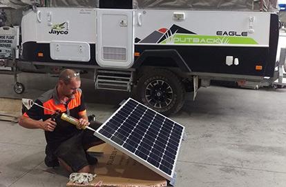 Caravan Electrical - Man Fixing Solar Panels - Caravan-Electrics