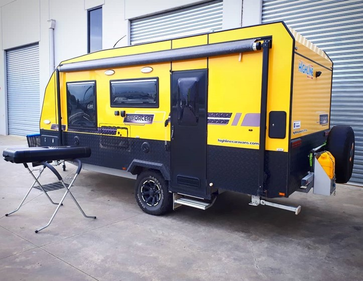 Yellow Caravan being repaired and modified