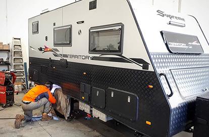 Man Servicing A Caravan